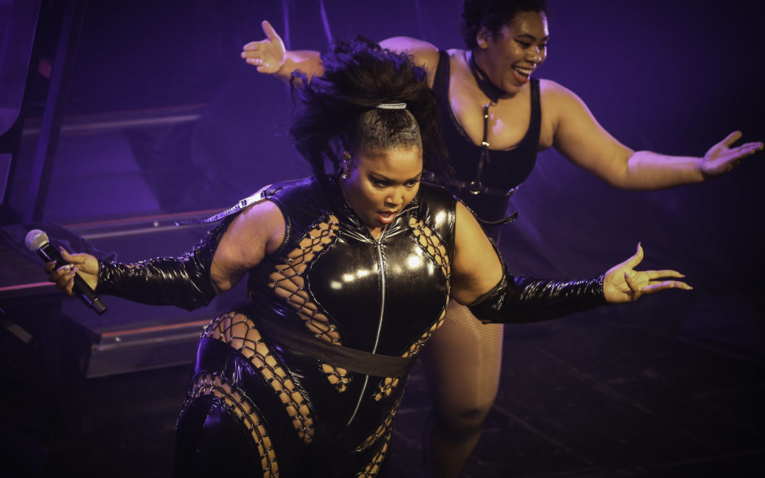 Lizzo stuns in gold dress in honor of 'plus size appreciation day:' 'We are sex symbols'